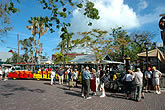 people at Mallory Square standing next to conch tour train